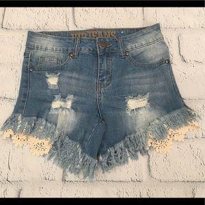 Lace edged fringed jean shorts